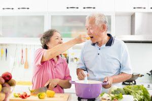 Elderly couple eating healthy food
